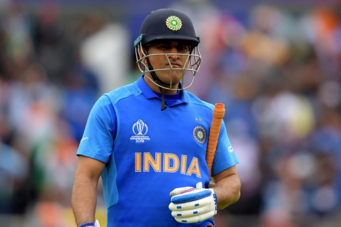 "Former captain Sourav Ganguly and VVS Laxman said India committed a ""tactical blunder"" by demoting Mahendra Singh Dhoni to number seven in the World Cup semifinal against New Zealand, a move that left them baffled. (AFP Photo)"