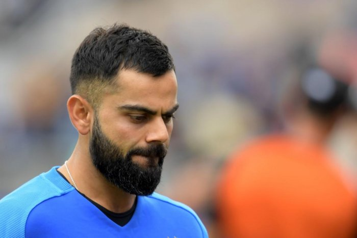 Virat Kohli reacts at the end of play during the 2019 Cricket World Cup first semi-final between New Zealand and India at Old Trafford in Manchester. New Zealand beat India by 18 runs. AFP