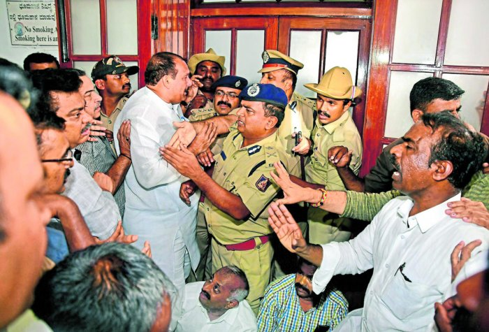Police intervene after BJP leaders protest the detention of MLA K Sudhakar in Vidhana Soudha. DH photo/Krishnakumar P S