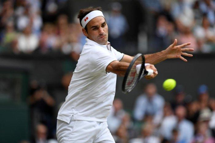 ON FIRE: Switzerland's Roger Federer returns during his win over Japan's Kei Nishikori during the men's singles quarterfinal on Wednesday.