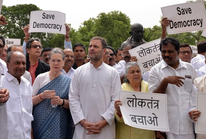 Congress MPs, led by CPP leader Sonia Gandhi, party leader Rahul Gandhi, stage a protest outside at Parliament House on Thursday, against the 'attempts' by the BJP to unsettle coalition government in Karnataka. AFP