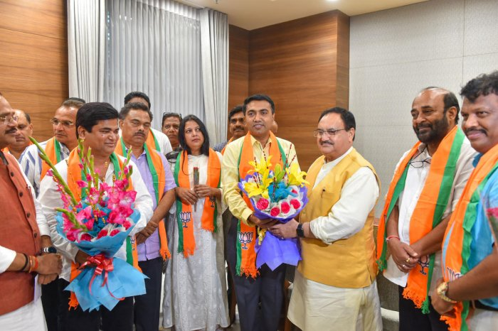 BJP Working President JP Nadda with Goa Chief Minister Pramod Sawant (yellow shirt), Chandrakant Babu Kavlekar, the leader of opposition in the Goa Assembly, and other Goa Congress rebel MLAs, in New Delhi on Thursday. PTI photo