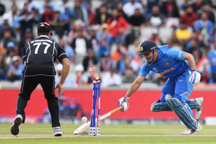 India's Mahendra Singh Dhoni was run out during the 2019 Cricket World Cup first semi-final between New Zealand and India at Old Trafford in Manchester, northwest England, on July 10, 2019. (Photo by AFP)