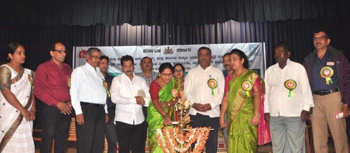 Chikkamagaluru Zilla Panchayat President Sujatha Krishnappa inaugurates World Population Day at Kuvempu Kala Mandira in Chikkamagaluru on Thursday. ZP Health and Education Standing Committee President Jacintha Anil Kumar looks on.