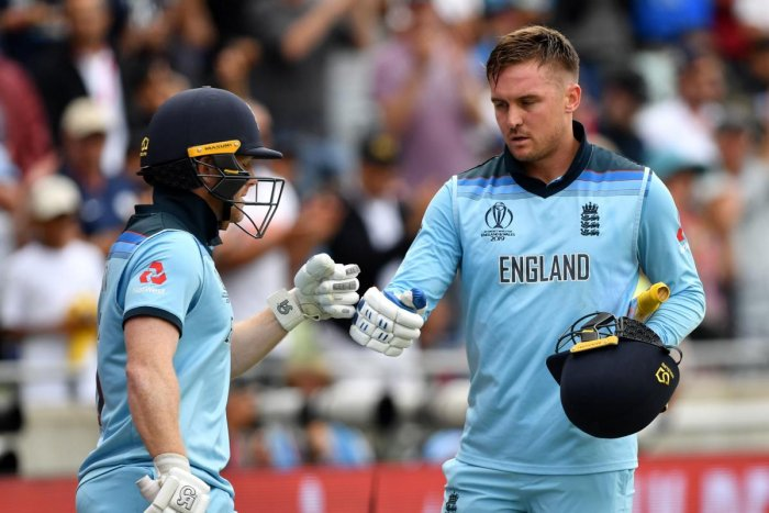 England's Joe Root (L) comes on as England's Jason Roy walks off for 85 during the 2019 Cricket World Cup. (AFP Photo)