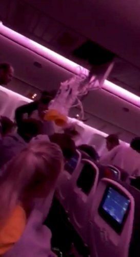 Oxygen masks fall during turbulence in the Air Canada (REUTERS Photo)