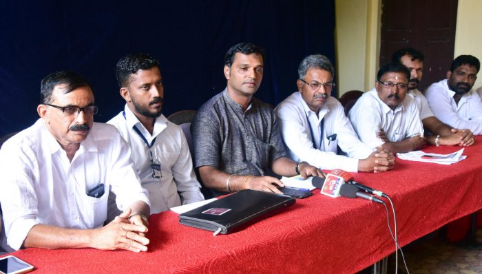Sunil Kumar Bajal, Dakshina Kannada District Schoolchildren Vehicle Drivers' Association honorary president, speaks to reporters in Mangaluru on Friday.