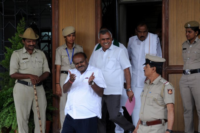 Chief Minister HD Kumaraswamy walks out of at Vidhana Soudha in Bengaluru on Thursday. | DH Photo: Pushkar V