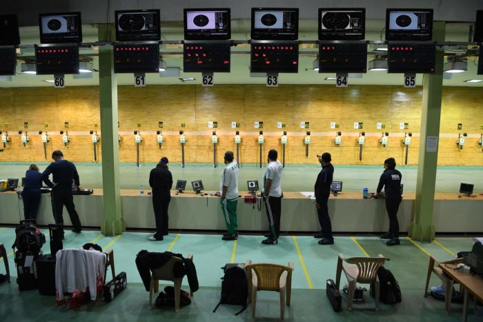 GEARING UP: Shooters practice at the Dr Karni Singh Range ahead of the World Cup. AFP