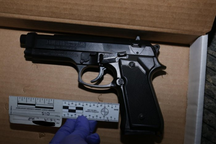 This unlocated handout photo released by the Orange County District Attorney's Office on July 9, 2019 shows a replica handgun designed to look identical to a Beretta 92 FS handgun which was recovered from near a shooting victim at the scene of an officer-