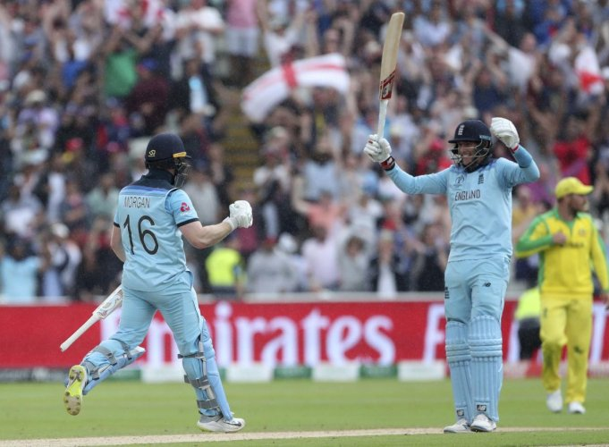 Birmingham: England's captain Eoin Morgan, left, and Joe Root celebrate their win over Australia in the Cricket World Cup semi-final match at Edgbaston in Birmingham, England, Thursday, July 11, 2019. AP/PTI