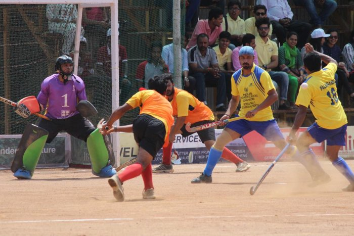 Aiming for a Goal: A match in progress during the Kodava Hockey Festival 2016 in Madikeri, Kodagu. Photos by DH, Niran Shantheyanda