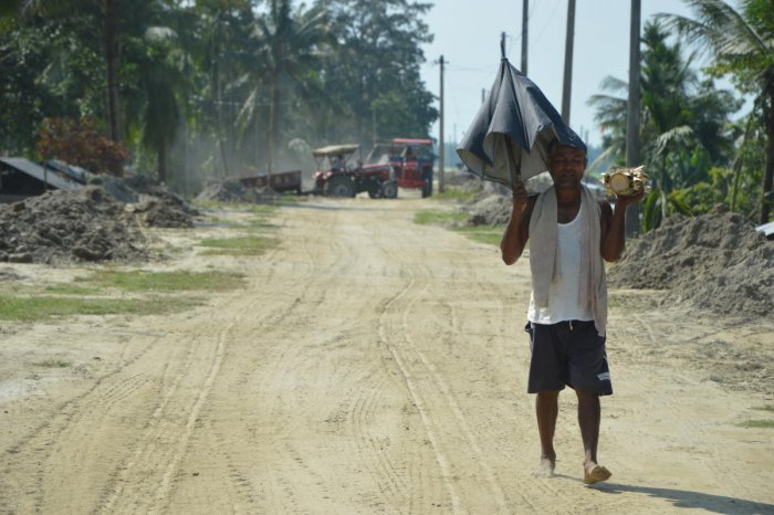 A man walks on the embankment encircling the Majuli island to protect it from annual floods.