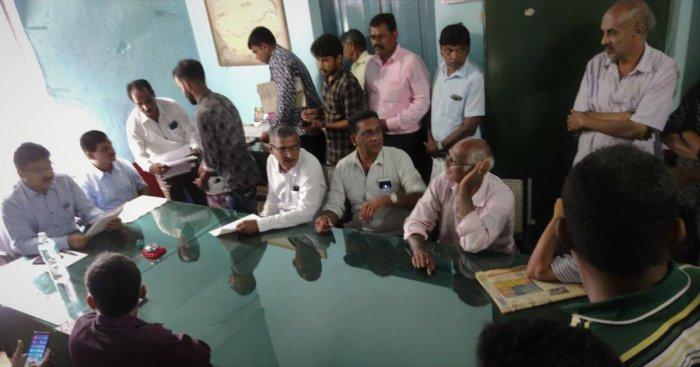 Assistant Commissioner Shivakumar and Tahsildar Ramesh at the revenue and pension adalat held at the Nada Kacheri in Kalasa.