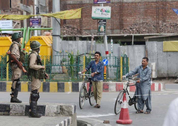Security personnel stand guard during restrictions at Downtown in Srinagar. (PTI Photo)