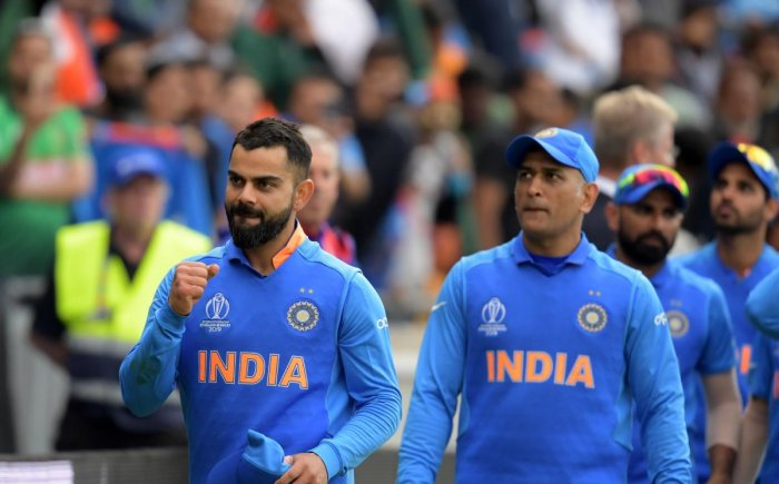 A dejected Indian team after losing the World Cup semifinal against New Zealand at Old Trafford on Wednesday. AFP