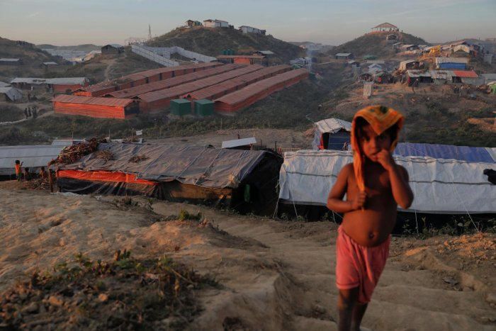 A Rohingya refugee child stands on a hill above the camp for widows and orphans inside the Balukhali camp near Cox's Bazar, Bangladesh. (Reuters File Photo)
