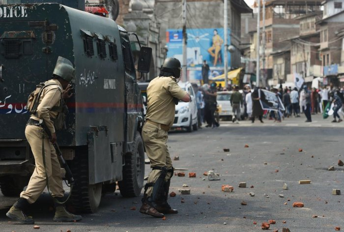 Police personnel chase people pelting stones during a clash which erupted soon after 'Jamaatul Vida' namaz prayers, at Nowhatta in Srinagar. (PTI File Photo)