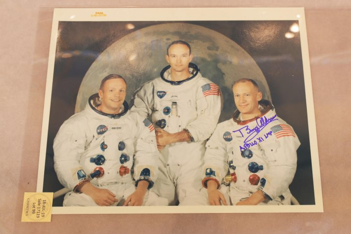 "A signed photograph of the Apollo 11 astronauts is displayed as part of Christie's upcoming ""One Giant Leap: Celebrating Space Exploration 50 Years After Apollo 11"" auction in New York, U.S., July 10, 2019. REUTERS/Lucas Jackson"