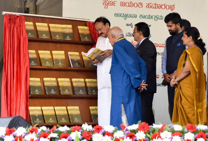 Vice President M Venkaiah Naidu takes a look at the journals published by the Central Institute of Indian Languages (CIIL) after inaugurating the golden jubilee celebrations of CIIL in Mysuru on Saturday. Founder director of CIIL D P Pattanayak, CIIL director D G Rao, MP Pratap Simha and Mayor Pushpalatha Jagannath are seen.
