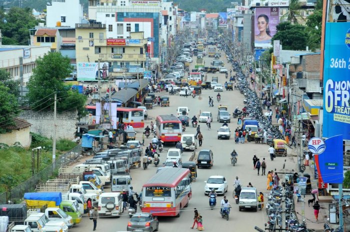 The increased density of vehicles on I G Road in Chikkamagaluru.