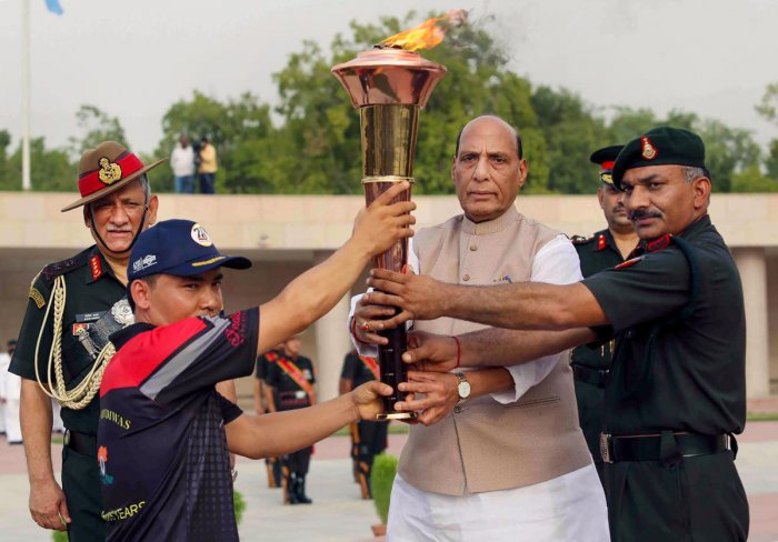 Defence Minister Rajnath Singh during the flag off ceremony of the 'Victory Flame' which will reach Drass on 'Vijay Diwas', at the National War Memorial in New Delhi. (PTI Photo)