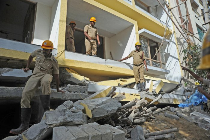 Five people were killed when two adjacent four-storey buildings slumped one after another in Cooke Town, Bengaluru, on July 10. DH FILE PHOTO