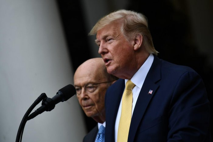 US President Donald Trump, flanked by US Secretary of Commerce Wilbur Ross, delivers remarks on citizenship and the census in the Rose Garden at the White House in Washington, DC, on July 11, 2019. (AFP)