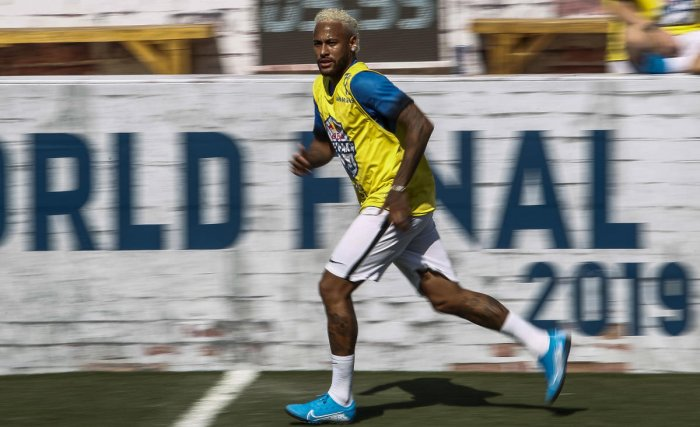 Brazilian football star Neymar runs during a five-a-side football tournament for his charity Neymar Junior Project Institute, in Praia Grande, Sao Paulo, Brazil, on July 13, 2019. (AFP)
