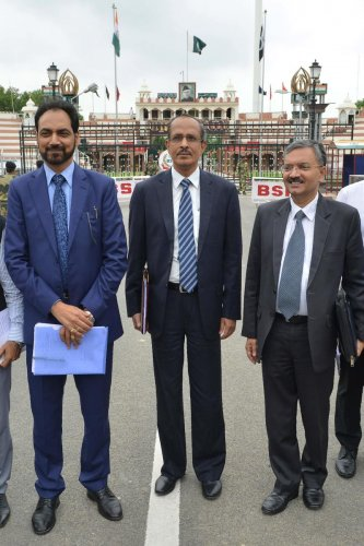 Joint Secretary of Indian Home Ministry SCL Das (C), Ministry of External Affairs joint Secretary Deepak Mittal (R) and Punjab Government PWD Secretary Hussan Lal (L) return to India after attending a meeting with their counterparts on the issue of Kartar