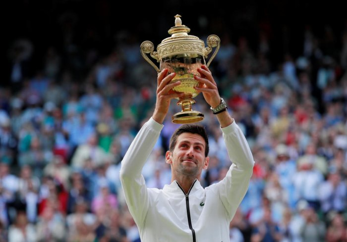 Serbia's Novak Djokovic poses with the trophy as he celebrates winning the final against Switzerland's Roger Federer. Reuters photo