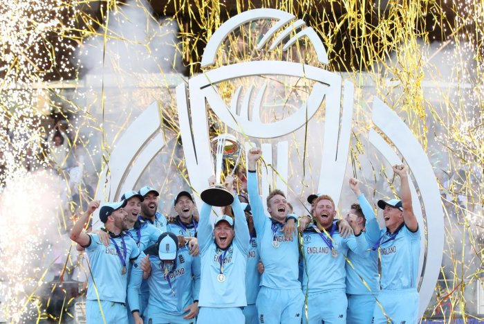 England celebrate winning the world cup with the trophy. Reuters