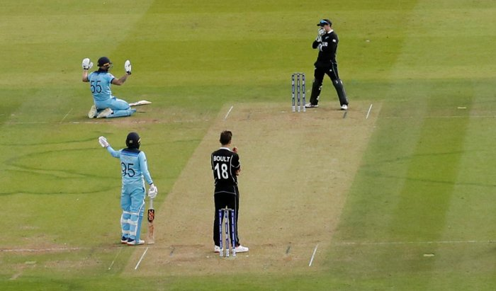 England's Ben Stokes apologises after an attempted run out hits his bat and goes for four (Reuters Photo)