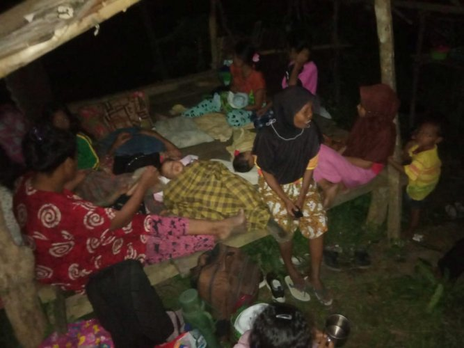 Locals stay outside their house following earthquake hit at Tokaka village in South Halmahera, North Maluku, Indonesia. Antara Foto/Safri via Reuters