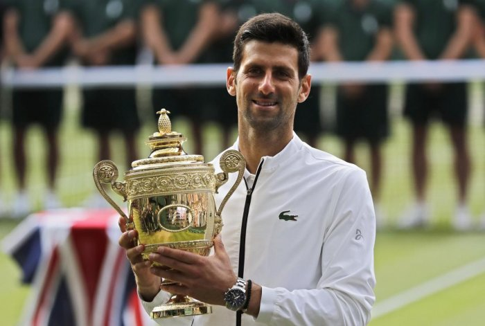 Serbia's Novak Djokovic poses with his trophy after defeating Switzerland's Roger Federer in the men's singles final match of the Wimbledon Tennis Championships in London (AP/PTI Photo)