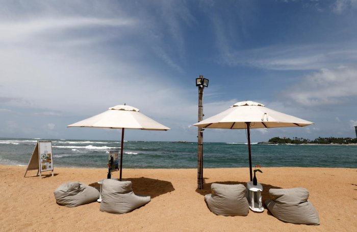 An empty beach is seen in front of the Pearl Divers, a diving school, at Unawatuna beach in Galle, Sri Lanka. (Reuters Photo)