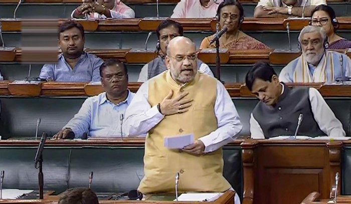 Union Home Minister Amit Shah speaks in the Lok Sabha during the Budget Session of Parliament, in New Delhi, Monday, July 15, 2019. (LSTV/PTI Photo)