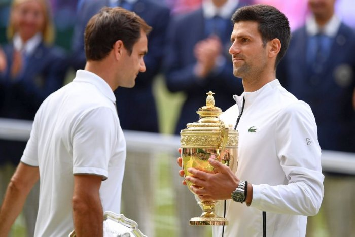 Roger Federer (left) and 2019 champion Novak Djokovic after the final. Picture credit: AFP
