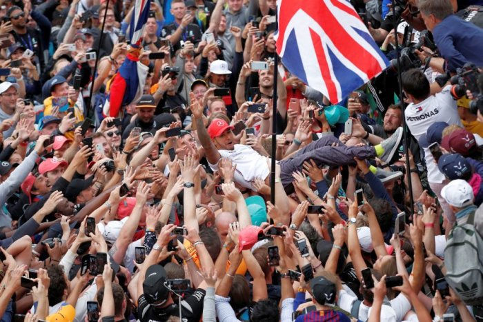Lewis Hamilton is a happy man after bagging the most British GP wins. Picture credit: Reuters