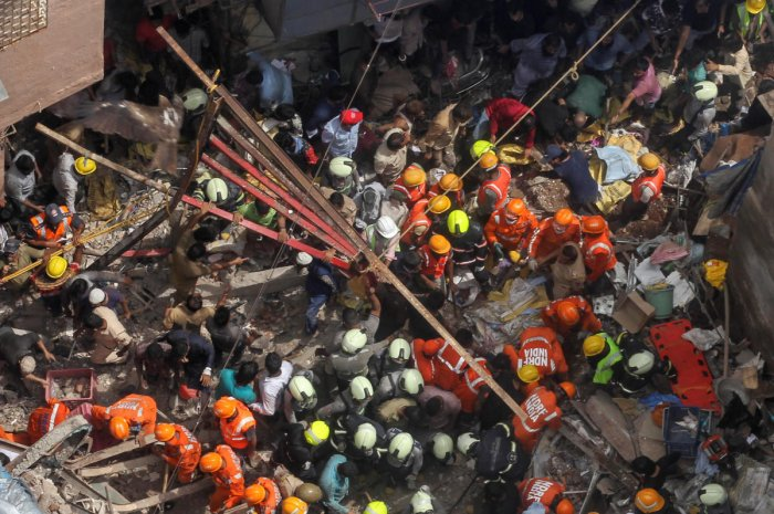 Rescue workers search for survivors at the site of a collapsed building in Mumbai. Reuters photo