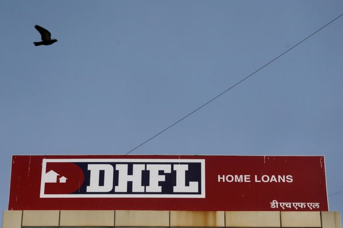 A bird flies past a signboard of Dewan Housing Finance Corporation Ltd. (DHFL) outside its office on the outskirts of Mumbai (Reuters file photo)