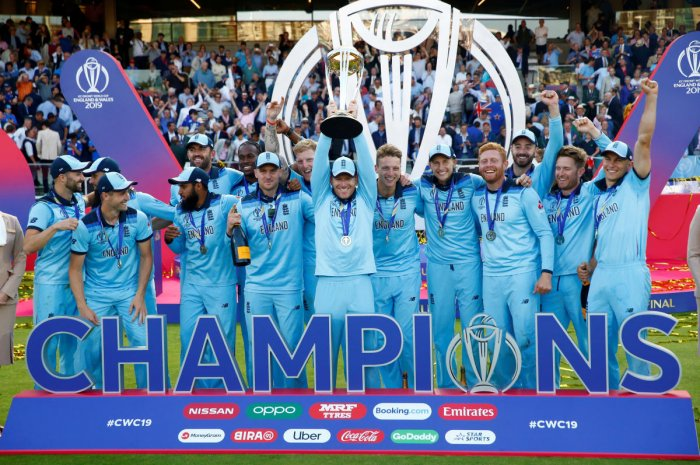 England's Eoin Morgan and teammates celebrate winning the ICC Cricket World Cup Finals with the trophy at Lord's, London, Britain. Action Images via Reuters