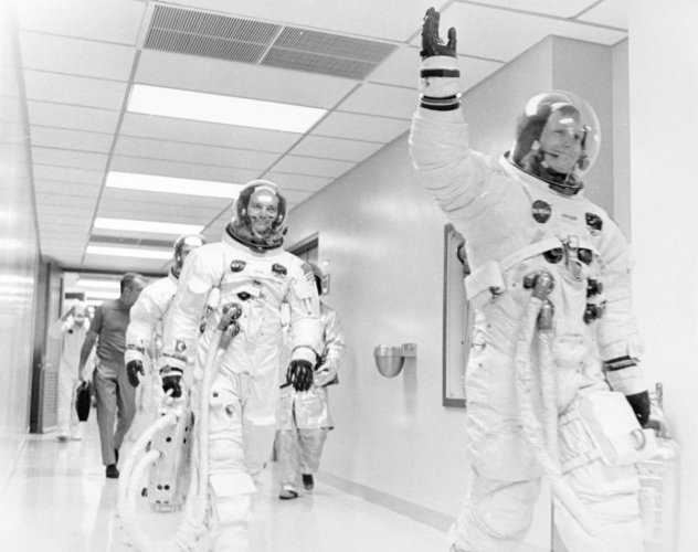 Mike Collins, Buzz Aldrin and Deke Slayton (dark shirt behind Aldrin to the left) follow Armstrong down the hallway. (Reuters File Photo)