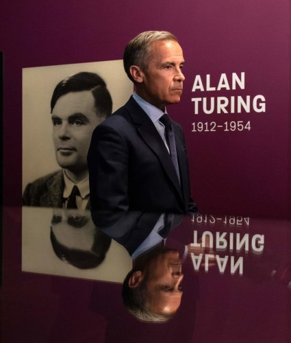 Mark Carney, governor of the Bank of England, is interviewed after attending at a press conference announcing the concept design for the new Bank of England fifty pound banknote, featuring mathematician and scientist Alan Turing, during the presentation a