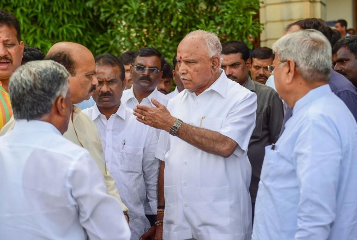 BJP State President B S Yeddyurappa with party leaders after the speaker announced that the vote of confidence will happen on Thursday, during the State Assembly session at Vidhana Soudha in Bengaluru on Monday. PTI photo