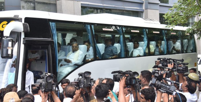 Congress legislators, led by CLP leader Siddaramaiah, leave Vivanta by Taj after the CLP meeting on Monday.