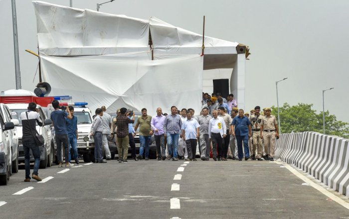 Delhi Chief Minister Arvind Kejriwal with his ministers and officials at the inauguration of the newly-constructed Rao Tula Ram Flyover, near Munirka in New Delhi. (PTI Photo)