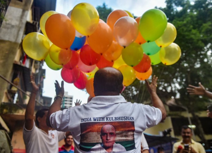 Supporters of Kulbhushan Jadhav celebrate after International Court of Justice's verdict, in Mumbai on Wednesday. PTI photo