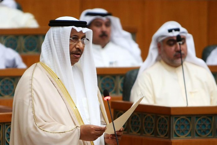 Kuwaiti Prime Minister Sheikh Jaber al-Mubarak al-Sabah (L) delivers a speech during a parliament session at Kuwait's national assembly, in Kuwait City. (AFP Photo)