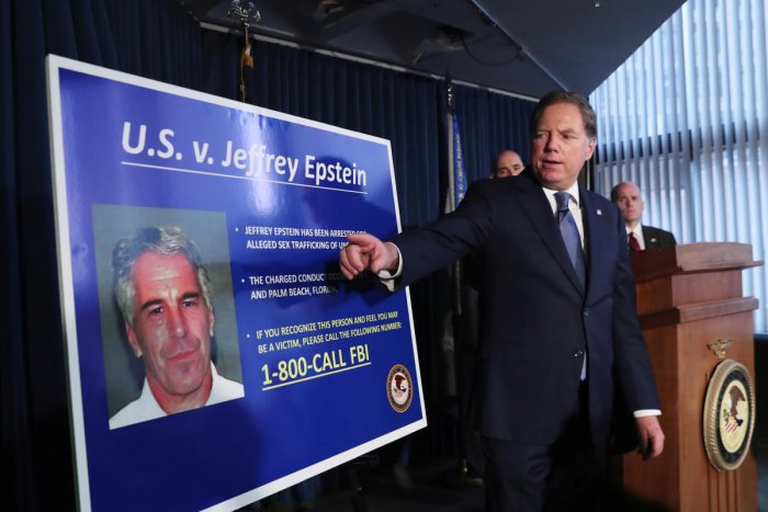 Geoffrey Berman, US Attorney for the Southern District of New York, points to a photograph of Jeffrey Epstein as he announces the financier's charges of sex trafficking of minors and conspiracy to commit sex trafficking of minors (Reuters Photo)